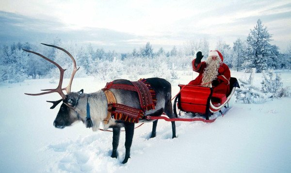 SANTA RIDES WITH REINDEER IN FINLAND